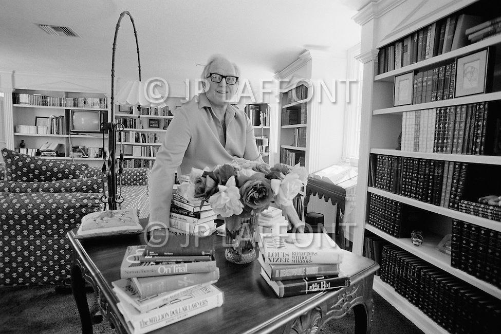 April 1979, Beverly Hills, California, USA. Academy Award-winning American writer Sidney Sheldon amongst his collection of books at his home, in Beverly Hills. Sidney Sheldon's vast career earned him the title of the seventh best selling writer of all time. The most well-known of his novels Master of the Game, The Other Side of Midnight and Rage Of Angels, which also became a TV series.