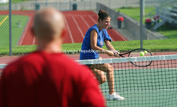 SOUTHBURY, CT 7/30/07- 073007BZ03- Laura Curley, 19, of Waterbury, returns a shot to Sean Brady, an instructor at the Middlebury Racquet Club, during a tennis lesson at the Pomperaug High School tennis court Monday afternoon.  Curley said she plays for St. Joseph's College.<br /> Jamison C. Bazinet Republican-American