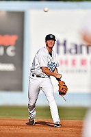Asheville Tourists shortstop Taylor Snyder (28) makes a throw to first base against the Hickory Crawdads at McCormick Field on July 14, 2017 in Asheville, North Carolina. The Crawdads defeated the Tourists 6-3. (Tony Farlow/Four Seam Images)