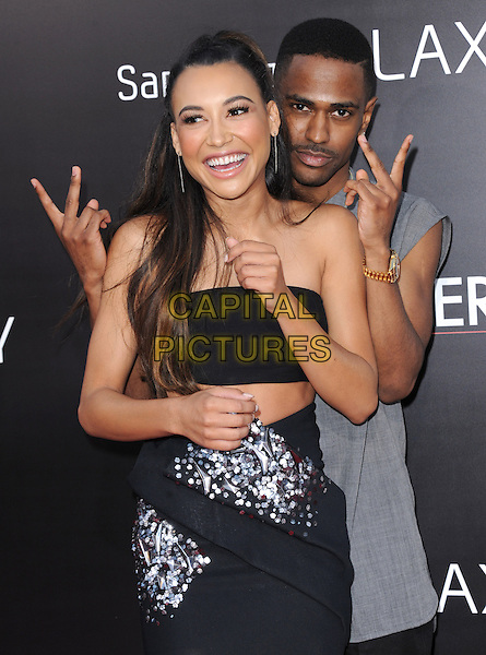 "Naya Rivera & Sean Michael Anderson (Big Sean).""The Hangover Part III"" Los Angeles Premiere held at the Westwood Village Theater, Los Angeles, California, USA..May 20th, 2013.half length black strapless dress top skirt cropped cut out away hands arms v peace sign smiling funny embellished jewel encrusted  couple belly stomach midriff.CAP/DVS.©DVS/Capital Pictures"