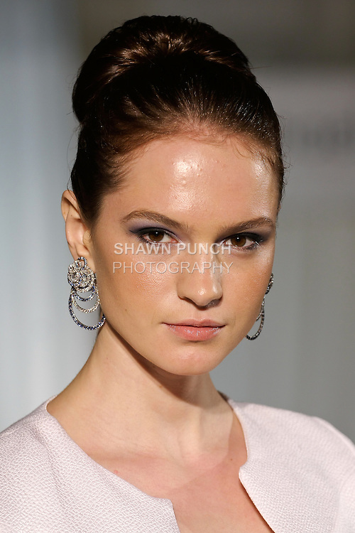 Tania walks runway in a  white cobra embossed silk, angular seamed top, from the b Michael AMERICA Couture Spring 2013 collection during Mercedes-Benz Fashion Week Spring 2013, at the Jumeirah Essex House on September 12, 2012.