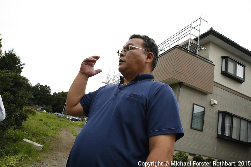 Civil engineer Kenichi Hayashi is one of 15,800 evacuees from Tomioka, a town in the Fukushima exclusion zone. He is also a decontamination supervisor working for Maruto, a construction company cleaning up Tomioka. Hayashi gives a tour of his former home and fields, which are currently getting decontaminated. Full caption to come.<br /> <br /> &copy; Michael Forster Rothbart Photography<br /> www.mfrphoto.com &bull; 607-267-4893<br /> 34 Spruce St, Oneonta, NY 13820<br /> 86 Three Mile Pond Rd, Vassalboro, ME 04989<br /> info@mfrphoto.com<br /> Photo by: Michael Forster Rothbart<br /> Date:  9/18/2015<br /> File#:  Canon &mdash; Canon EOS 5D Mark III digital camera frame B14789