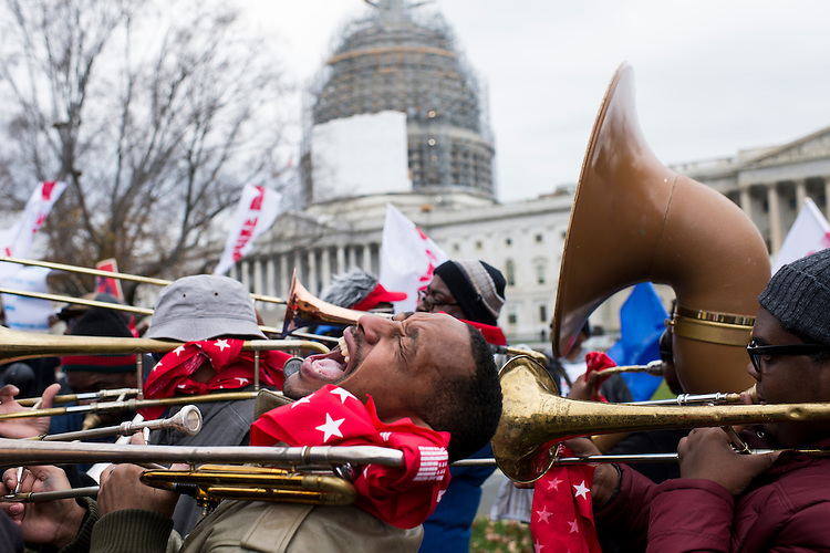 UNITED STATES - NOVEMBER 12: A trombone players yells as the brass band plays during the rally of striking Federal Contract Workers calling for higher wages at the Capitol on Thursday, Nov. 13, 2014. (Photo By Bill Clark/CQ Roll Call)