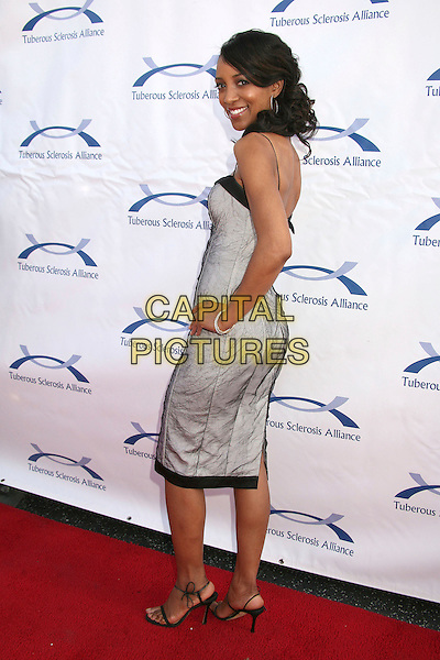 SHAUN ROBINSON .6th Annual Comedy For A Cure at The Music Box Theatre, Hollywood, California, USA..April 1st, 2007.full length grey gray dress hand on hip looking over shoulder .CAP/ADM/BP.©Byron Purvis/AdMedia/Capital Pictures