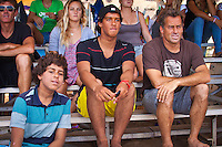 Tom Curren (USA) with sons Pat (far right) and Frank (centre) watching the action during the Reef Hawaiian Pro.  Haleiwa Hawaii, (Tuesday November 16, 2010) ..Haleiwa Ali'i Beach Park  turned on 3' surf for the second day of the 2010 Vans Triple Crown of Surfing.  The second round of the men's REEF Hawaiian Pro was completed today, along with the second of three heats of four of professional surfing all-time world champions in the REEF Clash of the Legends: Tom Curren (USA), Tom Carroll (Australia), Sunny Garcia (Hawaii), and Mark Occhilupo (Australia). ..Photo: joliphotos.com