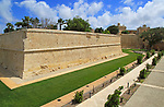 Defensive walls and moat ditch of medieval city of Mdina,  Malta