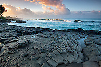 Basltic columns (columnar jointing) and sunrise, Poipu. Kauai, Hawaii.