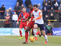 Alex Lawless of Luton Town under pressure during the Sky Bet League 2 match between York City and Luton Town at Bootham Crescent, York, England on 27 February 2016. Photo by Liam Smith.