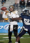 December 3, 2011:  Idaho quarterback Brian Reader throws in the first quarter as Nevada's 52 James-Michael Johnson rushes during a WAC league game played at Mackay Stadium in Reno, Nevada.