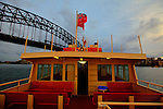 Onboard a Ferry leaving Circular Quays on this way to go under the Sydney Harbour Bridge, early in the morning.