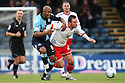 Leon Johnson of Wycombe and Chris Beardsley of Stevenage tussle. - Wycombe Wanderers v Stevenage - Adams Park, High Wycombe - 31st December 2011  .© Kevin Coleman 2011