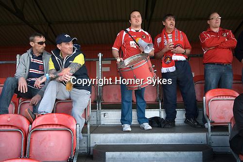 "The Fleet football team supporters at the ""home end"". Ebbsfleet v Tunbridge. Ebbsfleet Valley Kent UK. 2014"