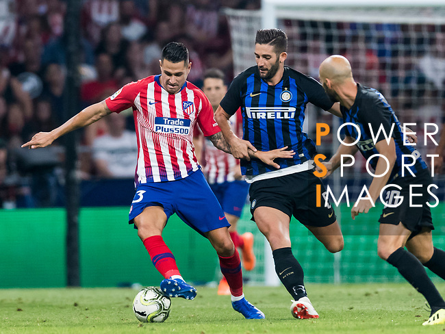 Victor Machin, Vitolo (L), of Atletico de Madrid fights for the ball with Roberto Gagliardini (C) and Borja Valero of FC Internazionale during their International Champions Cup Europe 2018 match between Atletico de Madrid and FC Internazionale at Wanda Metropolitano on 11 August 2018, in Madrid, Spain. Photo by Diego Souto / Power Sport Images