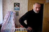Vitali Kaloyev mourns his children at home in their room in Vladikavkaz, in North Ossetia in southern Russia. The bed belonged to his daugter, Diana..The 52-year-old architect, who killed the air traffic controller blamed for the plane crash in which he lost his wife and two children, is being treated as a national hero..Kaloyev, who was freed November 2007 from a Swiss jail after serving less than four years, was appointed deputy construction minister for his home region..Kaloyev was building a holiday villa in Spain for a wealthy Russian when his wife Svetlana, 44, 10-year-old son Konstantin and four-year-old daughter Diana, set out to join him for a holiday in July 2002. As their plane flew over Germany it collided with a cargo jet killing all 71 people on board, most of them Russian schoolchildren..Investigators later established that Peter Nielsen, a Dane working for Skyguide, the Swiss air-traffic control service at Zurich airport, was the only person on duty. He had panicked when he realised the two planes were on a collision course and gave wrong instructions to the pilots..Like other bereaved relatives, Kaloyev grew angry at the slow pace of the investigation and the way Skyguide, fearful of lawsuits, sought to place the blame on others..Kaloyev claims he cannot remember what happened next, but does not deny stabbing Nielsen several times with a pocket knife. Nielsen bled to death before an ambulance could reach him. Kaloyev was arrested the following day and was sentenced to eight years for manslaughter.