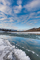 Ice begins to form on the Koyukuk River in the Brooks Range as winter comes to this scenic landscape.