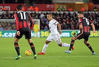 Wayne Routledge of Swansea (C) attempts to get past Charlie Daniels (L) and Andrew Surman (R) of Bournemouth during the Barclays Premier League match between Swansea City and Bournemouth at the Liberty Stadium, Swansea on November 21 2015