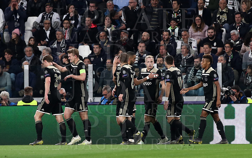 Football Soccer: UEFA Champions UEFA Champions League quarter final second leg Juventus - Ajax, Allianz Stadium, Turin, Italy, March 12, 2019. <br /> Ajax's Donny van de Beek (c) celebrates after scoring with his temmates during the Uefa Champions League football match between Juventus and Ajax  at the Allianz Stadium, on March 12, 2019.<br /> UPDATE IMAGES PRESS/Isabella Bonotto