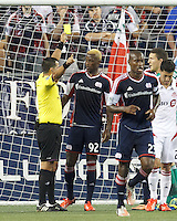 Yellow Card: New England Revolution forward Dimitry Imbongo (92). In a Major League Soccer (MLS) match, Toronto FC (white/red) defeated the New England Revolution (blue), 1-0, at Gillette Stadium on August 4, 2013.