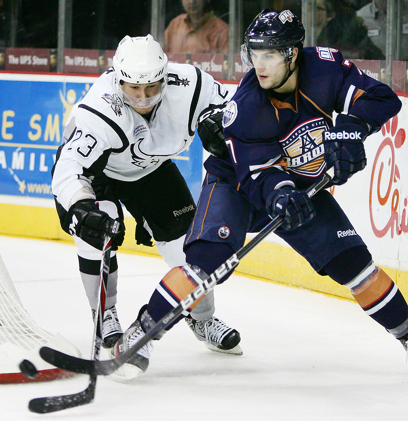 Oklahoma City Barons' Gilbert Brule, right, and San Antonio Rampage's Wacey Rabbit fight for the puck during the third period of an AHL hockey game, Saturday, Dec. 3, 2011, in San Antonio. San Antonio won 2-1. (Darren Abate/pressphotointl.com)