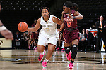 25 February 2016: Wake Forest's Ataijah Taylor (3) and Virginia Tech's Chanette Hicks (12). The Wake Forest University Demon Deacons hosted the Virginia Tech Hokies at Lawrence Joel Veterans Memorial Coliseum in Winston-Salem, North Carolina in a 2015-16 NCAA Division I Women's Basketball game. Virginia Tech won the game 54-48.