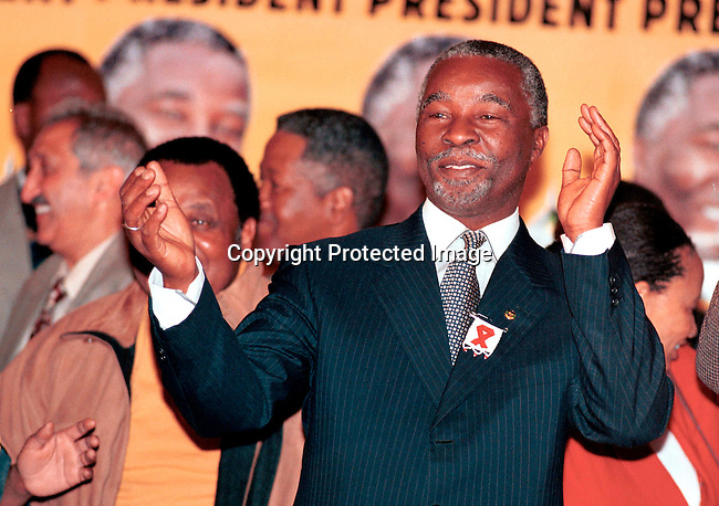 dipembe00002 .Personality President Thabo Mbeki of South Africa celebrating the election victory in June 1999 at Gallagers Estate outside Johannesburg. He was later in the month inagurated as the president of South Africa, as Nelson Mandela retired after one 5-year term..©Per-Anders Pettersson/iAfrika Photos