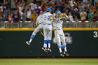 UCLA Bruins outfielders Eric Filia #4, Christoph Bono #3 and Brian Carroll #24 celebrate following Game 4 of the 2013 Men's College World Series between the LSU Tigers and UCLA Bruins at TD Ameritrade Park on June 16, 2013 in Omaha, Nebraska. The Bruins defeated the Tigers 2-1. (Brace Hemmelgarn/Four Seam Images)