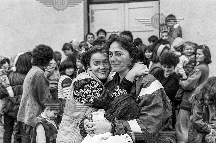 People living at the Varazdin refugee camp in the winter of 1992. <br /> <br /> In 1992 while volunteering at the Varazdin refugee camp Panos photographer Bjoern Steinz met and became close to Elvis, a Bosnian Muslim refugee, and his family. They shared the hardships of camp life together which Steinz documented. While the prints were archived for many years two of the images always returned to Bjoern's thoughts. 25 years later he set out to try and find out what had happened to Elvis and his family in the intervening years. Modern social media made the task surprisingly easy and they were reunited in Hadzici where Elvis now lives with his family.