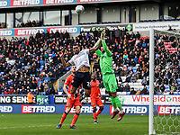 Bolton Wanderers' Josh Magennis competing with Millwall's goalkeeper Jordan Archer <br /> <br /> Photographer Andrew Kearns/CameraSport<br /> <br /> The EFL Sky Bet Championship - Bolton Wanderers v Millwall - Saturday 9th March 2019 - University of Bolton Stadium - Bolton <br /> <br /> World Copyright © 2019 CameraSport. All rights reserved. 43 Linden Ave. Countesthorpe. Leicester. England. LE8 5PG - Tel: +44 (0) 116 277 4147 - admin@camerasport.com - www.camerasport.com