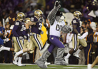Oct 09, 20010:  Washington Huskies mascot Harry leads the players out onto the field against Arizona State.   Arizona State defeated Washington 24-14 at Husky Stadium in Seattle, Washington...