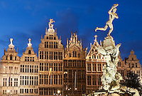 Belgium, Antwerp: Renaissance Guild Halls and Brabo Fountain in the Grote Markt at dusk