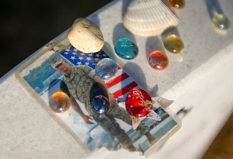 UNITED STATES - NOVEMBER 11: Mementos left at the grave of Marine Sgt. Christopher Hrbek in Section 60 at Arlington National Cemetery. Hrbek was killed January, 14, 2010 in Afghanistan by an IED. (Photo by Chris Maddaloni/CQ Roll Call)
