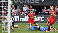 Portland, Oregon - Wednesday June 22, 2016: Portland Thorns FC forward Christine Sinclair (12) scores a goal during a regular season National Women's Soccer League (NWSL) match at Providence Park.
