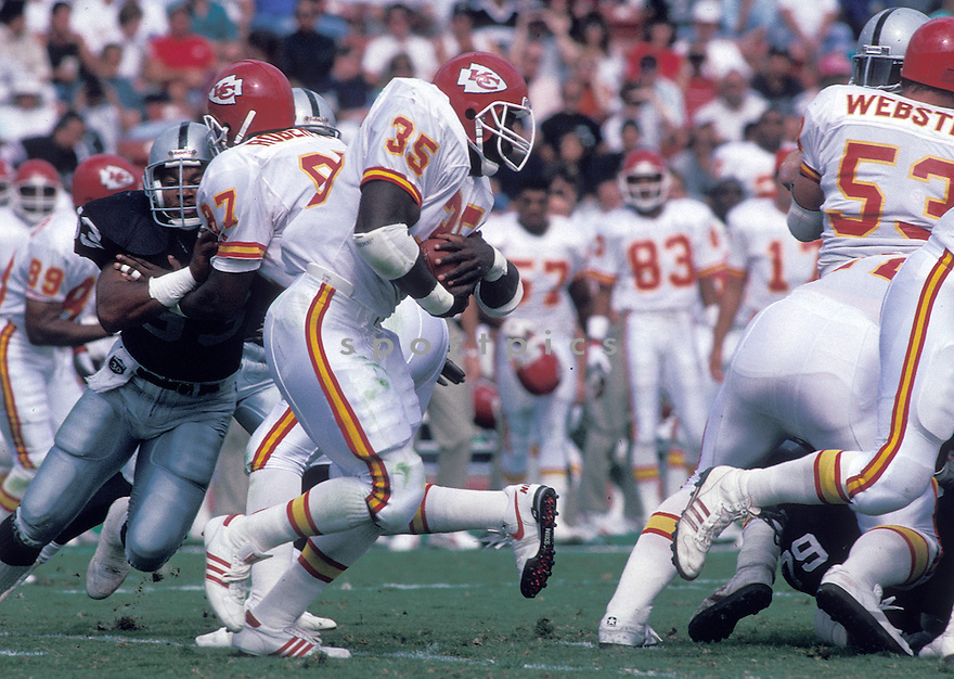Kansas City Chiefs Christain Okoye(51) in action during a game against the Los Angeles Raiders at Los Angeles Memorial Coliseum in Los Angeles, California on October 15, 1989.  The Raiders beat the Chiefs 20-14. Christain Okoye played for 6 years all with Chiefs and was a 2-time Pro Bowler.David Durochik/SportPics