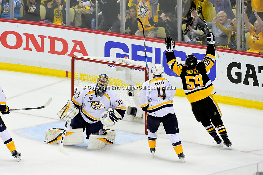May 29, 2017: Pittsburgh Penguins center Jake Guentzel (59) reacts to his goal against Nashville Predators goalie Pekka Rinne (35)  during game one of the National Hockey League Stanley Cup Finals between the Nashville Predators  and the Pittsburgh Penguins, held at PPG Paints Arena, in Pittsburgh, PA. Pittsburgh defeats Nashville 5-3 in regulation time.  Eric Canha/CSM