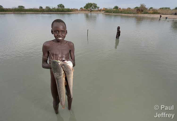 Marial Majak, 13, displays fish he caught in Poktap, a town in South Sudan's Jonglei State where conflict, drought and inflation have caused severe food insecurity. <br /> <br /> Parental consent obtained.