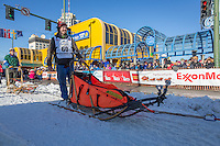 Alex Buetow and team leave the ceremonial start line at 4th Avenue and D street in downtown Anchorage during the 2014 Iditarod race.<br /> Photo by Jim R. Kohl/IditarodPhotos.com