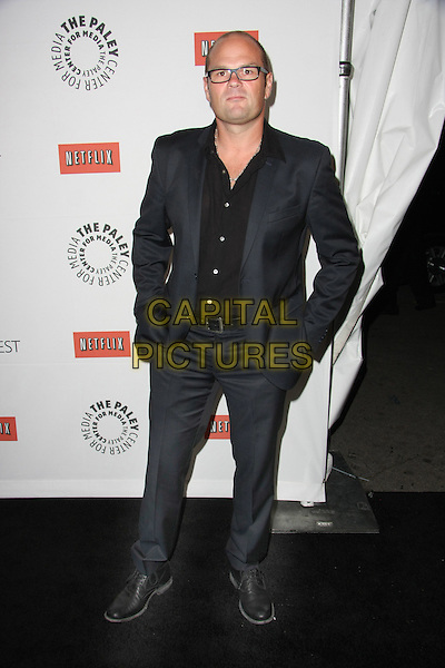 """CHRIS BAUER .""""True Blood"""" at PaleyFest 2011  Held at The Saban Theater, Beverly Hills, California, USA, 5th March 2011..full length grey gray suit hands in pockets glasses black shirt .CAP/ADM/TB.©Tommaso Boddi/AdMedia/Capital Pictures."""