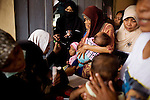 Volunteers from Indonesia's humanitarian non-governmental organization pay a visit to one of the Mt. Merapi evacuee camps, a temporary home for about 1500 villagers, by providing trauma healing for children, medicine and nutrition, outside of Yogyakarta, Indonesia, on Tuesday, Nov. 10, 2010.