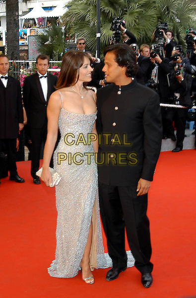 LIZ HURLEY & ARUN NAYAR.Cannes Film Festival 2003.long silver dress, metallic.www.capitalpictures.com.sales@capitalpictures.com.©Capital Pictures