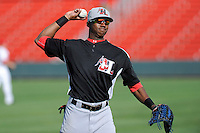 Outfielder Lewis Brinson (27) of the Hickory Crawdads before in a game against the Greenville Drive on Friday, June 7, 2013, at Fluor Field at the West End in Greenville, South Carolina. Brinson is the No. 12 prospect of the Texas Rangers, according to Baseball America and was a first-round pick (29th overall) in the 2012 First-Year Player Draft. Greenville won the resumption of this May 22 suspended game, 17-8. (Tom Priddy/Four Seam Images)