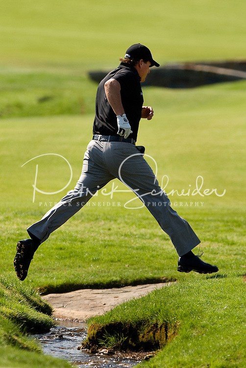 PGA golfer Phil Mickelson jumps a creek on the 18th hole during the 2008 Wachovia Championships at Quail Hollow Country Club in Charlotte, NC.