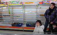 Empty shelves at a small supermaket in Fukushima city, about 60 km from the Fukushima Daiichi Nuclear Power Plant. Plant was damaged during the  Earhquake and following Tsunami that struck Japan on 11th March 2011.  With no power or running water and limited supplies of food, people in affected regions are surviving on little food and water, many supermarket stores are queued up with clients buying food and beverages and the stores didn't have many supplies left. .17 Mar 2011