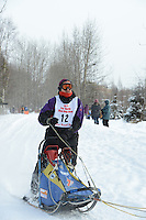 Egil Ellis passes by University Lake during the first day of the World Championship Sled Dog Races, a highlight of the 2013 Anchorage, Alaska, Fur Rendezvous.