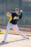 Brian Fuentes #57 of the Oakland Athletics participates in spring training workouts at the Athletics complex on February 23, 2011  in Phoenix, Arizona. .Photo by:  Bill Mitchell/Four Seam Images.