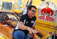 Sep 2, 2016; Clermont, IN, USA; Papa Johns pizza founder John Schnatter in attendance with his original gold Chevrolet Camaro during NHRA qualifying for the US Nationals at Lucas Oil Raceway. Mandatory Credit: Mark J. Rebilas-USA TODAY Sports