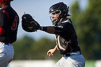 West Virginia Black Bears catcher Daniel Arribas (23) tags out Giovanny Alfonzo (8) during a rundown during a game against the Batavia Muckdogs on August 30, 2015 at Dwyer Stadium in Batavia, New York.  Batavia defeated West Virginia 8-5.  (Mike Janes/Four Seam Images)