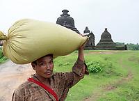 A Farmer carrying his load near the Lay Myat Na Temple, Mrauk U, Myanmar