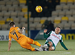 29.03.2019 Livingston v Hibs: Mark Milligan and Keaghan Jacobs go for a 50-50