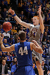 SIOUX FALLS, SD - MARCH 11:  Tony Fiegen #34 of South Dakota State gets the ball knocked away by Joe Reed #44 of IPFW during their semi-final game at the 2013 Summit League Basketball Championships Monday at the Sioux Falls Arena.  (Photo by Dick Carlson/Inertia)