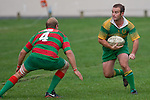 P. Sefontaine weighs up the options as D. Duley readies himself for the tackle. Counties Manukau Premier Club Rugby round 5 game between Waiuku and Drury played at Waiuku on the 12th of May 2007. Waiuku led 33 - 0 at halftime and went on to win 57 - 5.